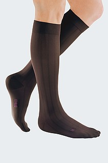 mans leg with compression stocking